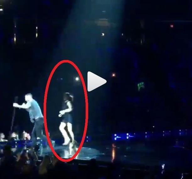 adam levine hug by fans onstage